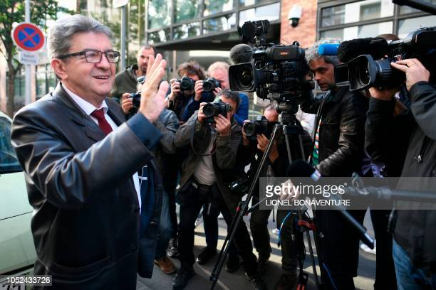 The leader of the French leftist party La France Insoumise and member of parliament Jean-Luc Melenchon waves as he as he arrives for a hearing at the...