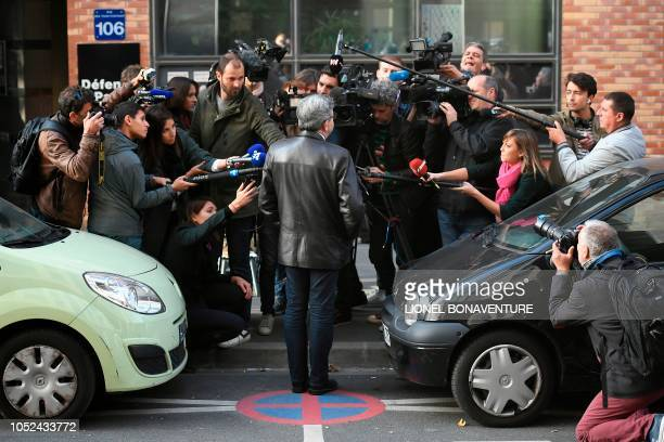 TOPSHOT The leader of the French leftist party La France Insoumise and member of parliament JeanLuc Melenchon gives a press point as he arrives for a...