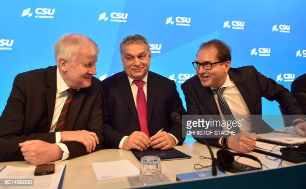 The leader of the German Christian Social Union Party Horst Seehofer chairman of the CSU regional group in the Bundestag Alexander Dobrindt and Prime...