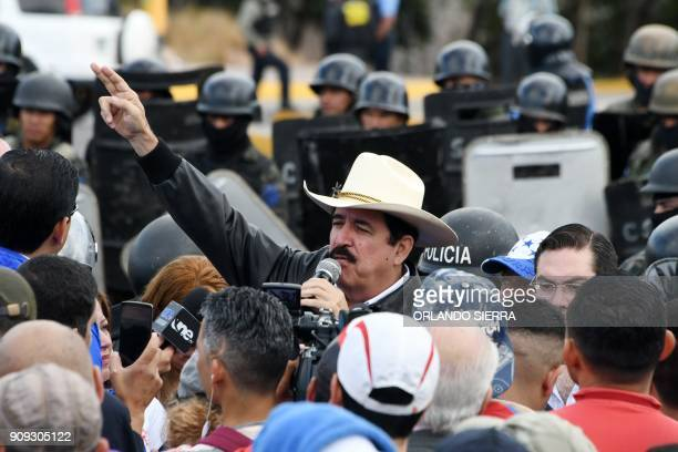 The leader of the Honduran Opposition Alliance Against the Dictatorship in the past election Manuel Zelaya leads a protest outside Congress as...