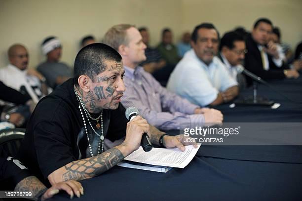The leader of the Mara Salvatrucha gang Carlos Alberto Valladares reads a press release during a press conference at La Esperanza Penitenciary in San...