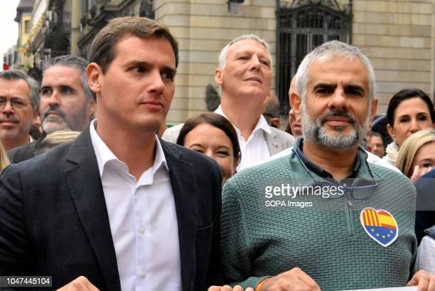 The leader of the political party Ciudadanos Albert Rivera seen standing next to the deputy of the Parliament of Catalonia Carlos Carrizosa during...