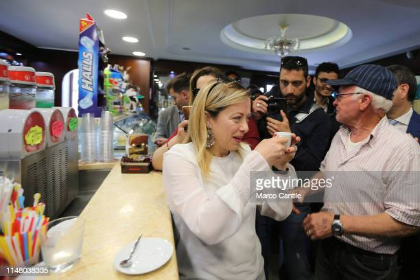 The leader of the political party Fratelli d'Italia Giorgia Meloni takes a coffee with her political supporters before a political meeting in Castel...