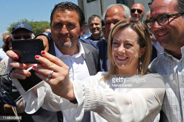 The leader of the political party Fratelli d'Italia Giorgia Meloni takes a selfie with her mayor candidate Luigi Petrella before a political meeting...