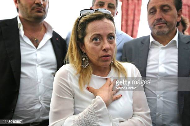 The leader of the political party Fratelli d'Italia Giorgia Meloni and mayor candidate Luigi Petrella speaks with journalists during a political...