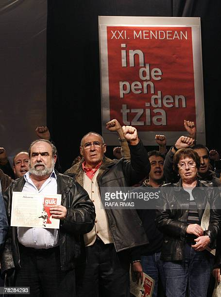The leader of the proindependence political party Basque Nationalist ActionANV Kepa Bereziartua and other ANV members sing The International during a...