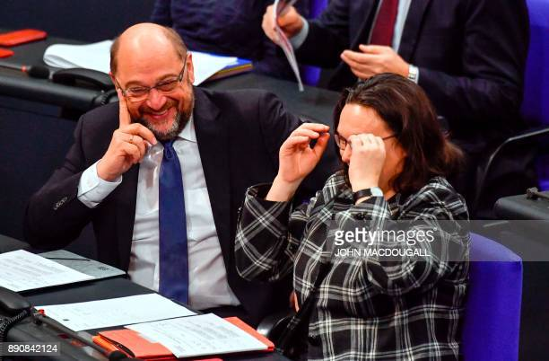 The leader of the Social Democratic Party Martin Schulz and parliamentary group leader of the SPD Andrea Nahles share a laugh as they attend a...