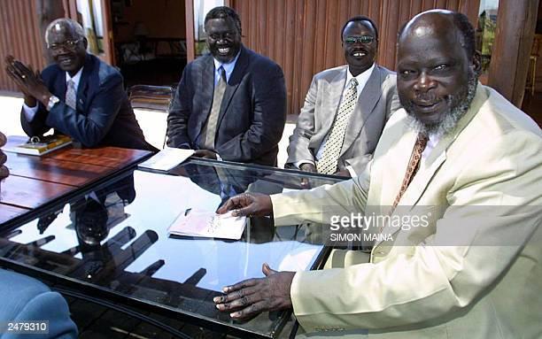 The leader of the Sudan People Liberation Army John Garang consults with his delegation 05 September 2003 Riek Machar Malik Agar and Elijah Malow...
