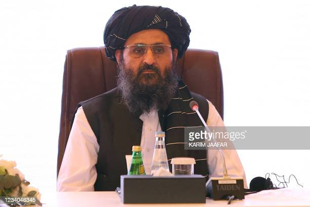 The leader of the Taliban negotiating team Mullah Abdul Ghani Baradar looks on during the final declaration of the peace talks between the Afghan...