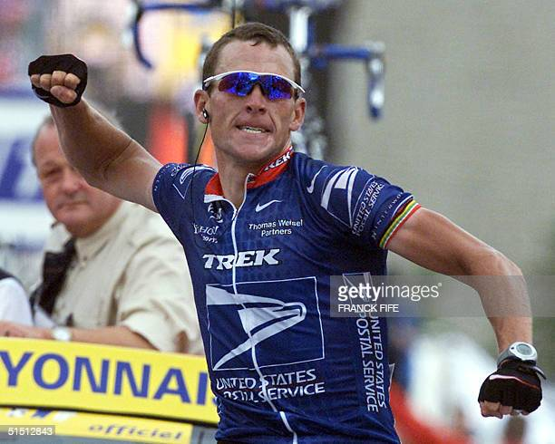 the leader of the US Postal team US Lance Armstrong jubilates after winning the 10th stage of the 88th Tour de France in l'Alpe d'Huez 17 July 2001...