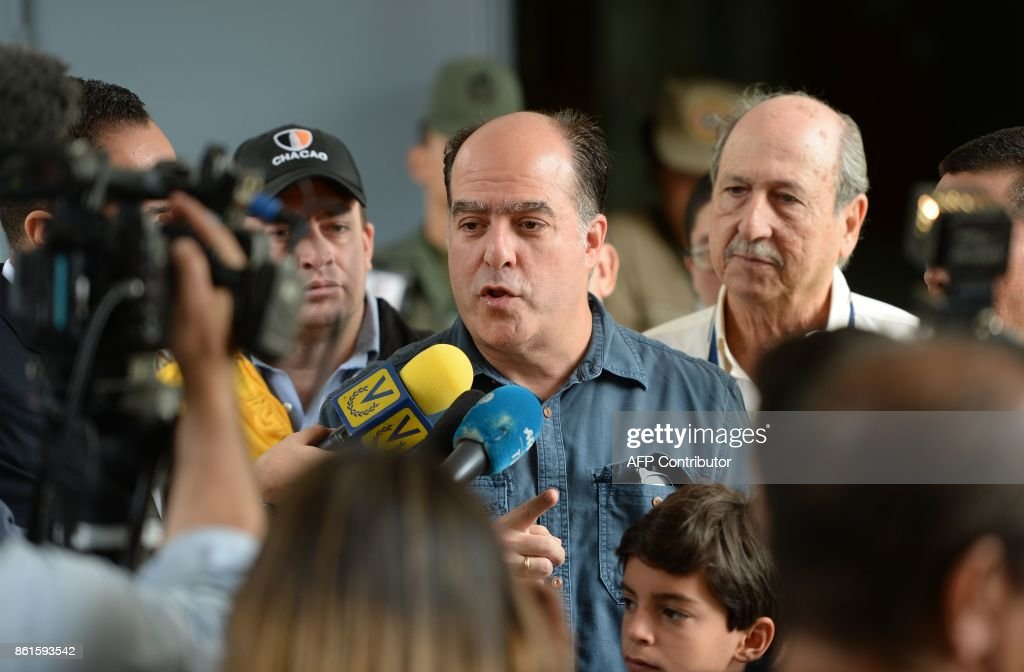 The leader of the Venezuelan opposition-held National Assembly, Julio Borges, speaks to the press at a polling station during regional elections in Caracas' municipality of Chacao, where people choose the governor for the state of Miranda, on October 15, 2017. Venezuelans headed to the polls Sunday in regional elections seen as a crucial test for President Nicolas Maduro and the opposition alike after months of deadly street protests failed to unseat him. An estimated 18 million people are eligible to elect governors to four-year terms in 23 states. / AFP PHOTO / Federico PARRA