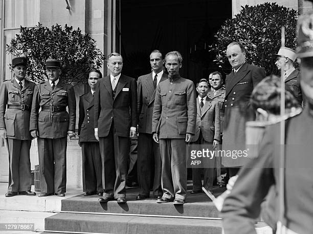 The leader of the vietnamese delegation Ho Chi Minh poses with French president of the provisional government Georges Bidault after talks, on June...