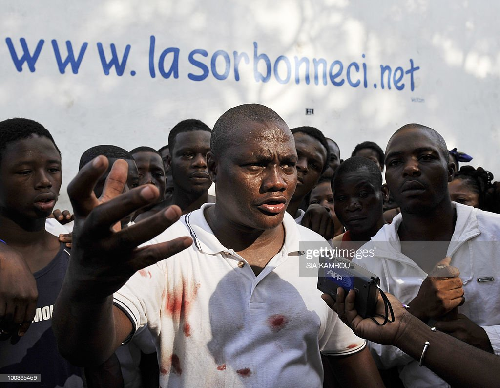 The leader of young supporters of Ivorian President Laurent Gbagbo, Nado Clement, speaks on May 24, 2010 after a protest against a decision of the municipality of Abidjan to evacuate them from the Sorbonne area of the Plateau business neighborhood of the economic capital. The Sorbonne area of the Plateau neighborhood has been a meeting place for the so-called Patriots for months.