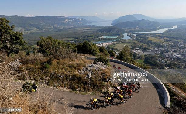 The leader's group, including Team Jumbo rider Slovenia's Primoz Roglic wearing the overall leader's yellow jersey and Team UAE Emirates rider...