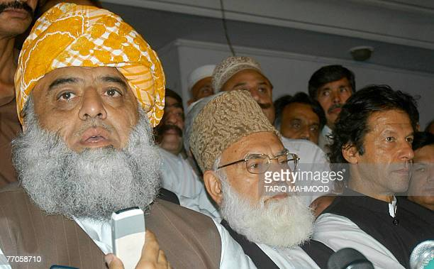 The leaders of All Parties Democratic Movement Maulana Fazlur Rehman talks to media representatives as Qazi Hussain Ahmed and Imran Khan look on...