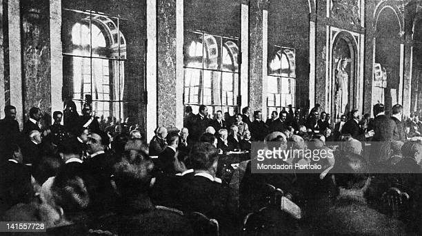 The leaders of different Powers discussing peace in the Hall of Mirrors at the Trianon Palace of Versailles Versailles 28th June 1919