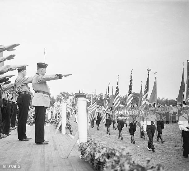 The leaders of German American Bund give the Nazi salute to young men and women marching in Nazi uniforms The event was a German Day celebration...