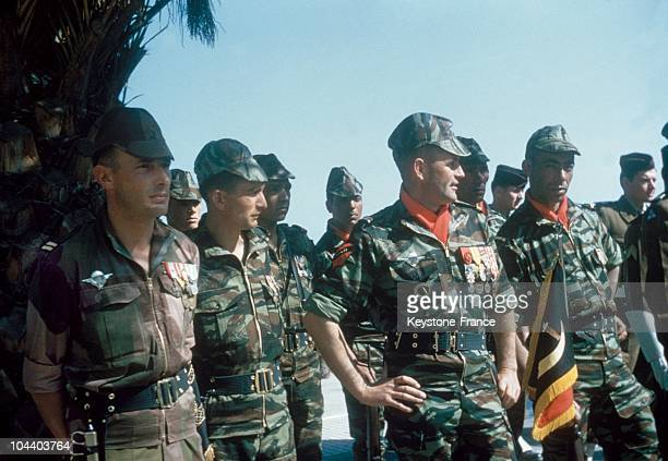 The leaders of the commandos formed by Colonel BIGEARD at Saida to track the NLF's commandos came to pay honors to General CHALLE who is being...
