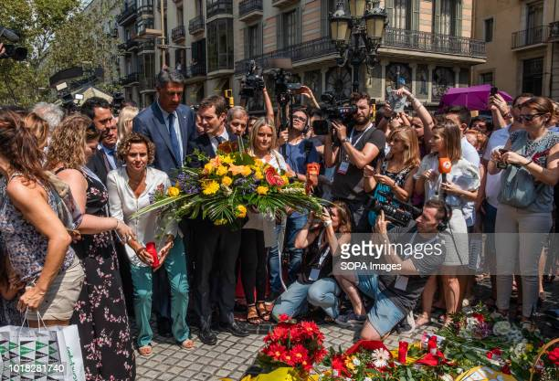 The leaders of the Spanish Popular Party Xavier Albiol and Pablo Casado are seen depositing bouquets of flowers at the Ramblas Barcelona celebrated...