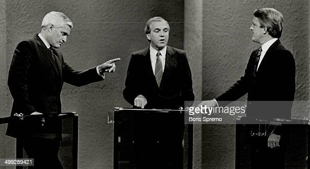 The leaders Prime Minister John Turner points the finger at Tory leader Brian Mulroney while NDP leader Ed Broadbent looks on during first televised...