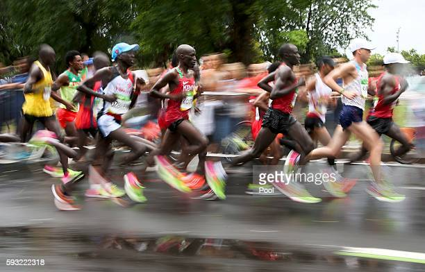 The leading group of runners compete in the men's marathon at the 2016 Rio Olympics at the Sambodrome August 21, 2016 in Rio de Janeiro, Brazil.