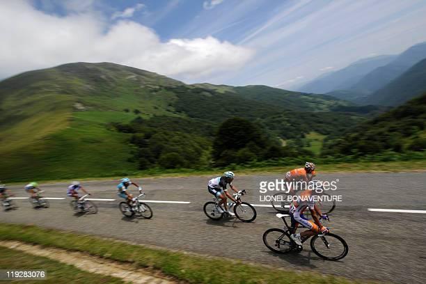The leading men Spain's LuisLeon Sanchez Spain's Ruben Perez Moreno and Denmark's Jakob Fuglsang ride in a breakaway in the 1685 km and fourteenth...