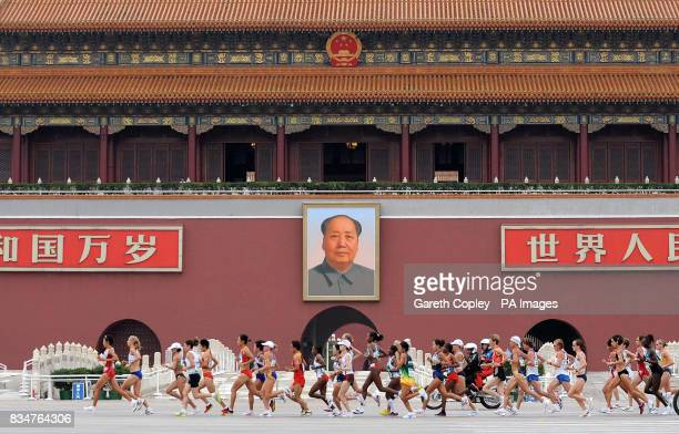 The leading pack in the women's Marathon run past the image of the late Chinese leader Mao Zedong, in the Forbidden City in Tiananmen Square during...