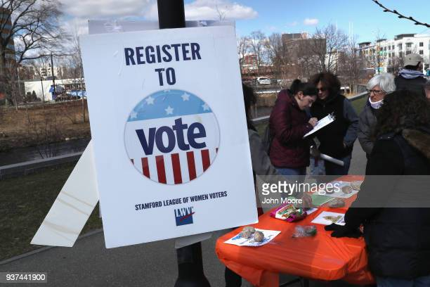 The League of Women Voters registers a new voter during the March for Our Lives rally on March 24 2018 in Stamford Connecticut More than 800 March...