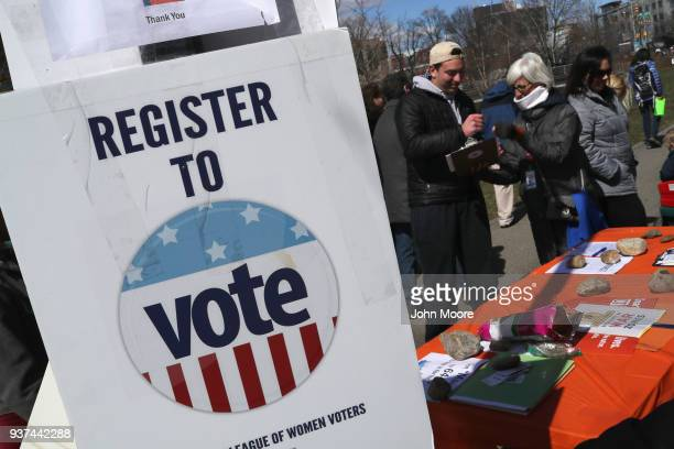 The League of Women Voters registers JD Anderson to vote during the March for Our Lives rally on March 24 2018 in Stamford Connecticut More than 800...