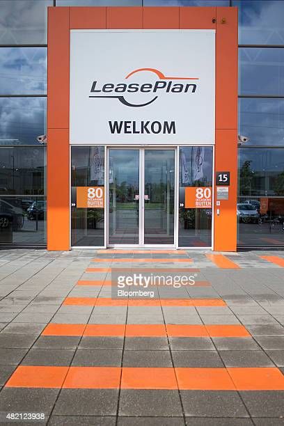 The LeasePlan Corp logo sits above the entrance to a used car leasing and contract automobile hire showroom in Breukelen Netherlands on Monday July...