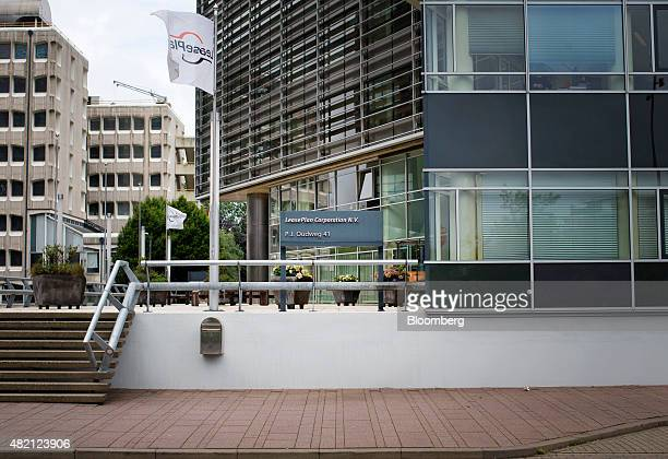 The LeasePlan Corp logo sits on a flag flying outside the car leasing and contract automobile hire company's headquarters in Almere Netherlands on...