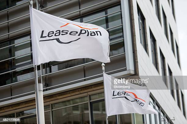 The LeasePlan Corp logo sits on flags flying outside the car leasing and contract automobile hire company's headquarters in Almere Netherlands on...