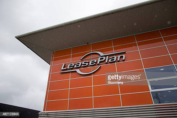The LeasePlan Corp logo sits on the exterior of the company's used automobile leasing and contract car hire showroom in Breukelen Netherlands on...