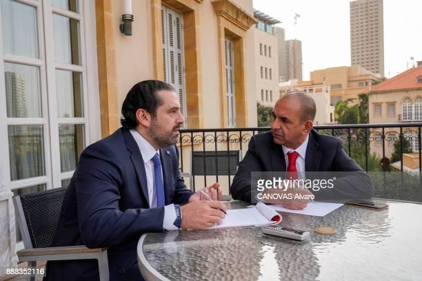 the Lebanese Prime Minister Saad Hariri with his advised Hani Hammoud are photographed for Paris Match at home on november 27 2017 in Beirut Lebanon