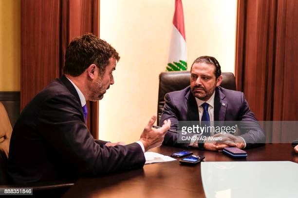 the Lebanese Prime Minister Saad Hariri with the journalist Regis Le Sommier are photographed for Paris Match on november 27 2017 in Beirut Lebanon