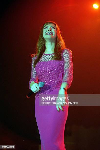 The Lebanon singer Nawal alZoghbi performs 01 January 2000 at the Maghreb Dance concert at the Paris/Bercy stadium in Paris Singers from Morocco...