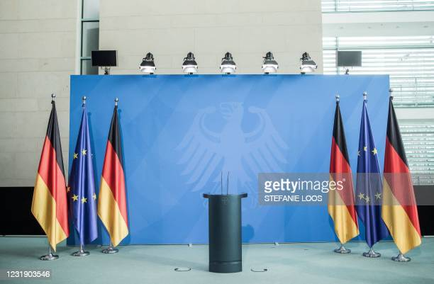 The lectern of German Chancellor Angela Merkel is pictured before a statement following talks via video conference with Germany's state premiers, at...