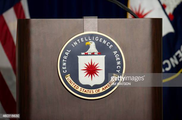 The lectern stands empty as reporters await the arrival of Director of Central Intelligence Agency John Brennan for a press conference at CIA...