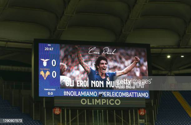 The LED board displays a picture of the deceased Paolo Rossi as players from both teams participate in a silence prior to the Serie A match between...