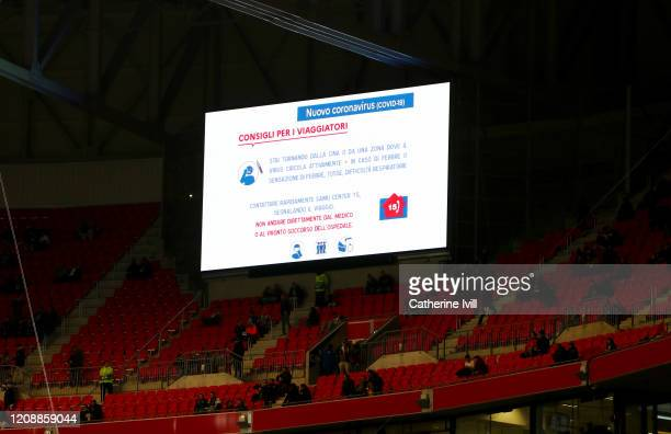 The LED board inside the stadium shows information for supporters about the Coronavirus prior to the UEFA Champions League round of 16 first leg...