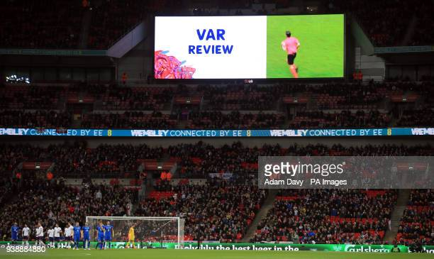 The LED Screen alerts the crowd to a VAR review resulting in a penalty for Italy during the international friendly match at Wembley Stadium London