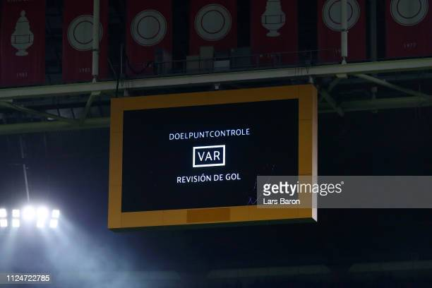 The LED screen dislays a message the the Video Assistant referee is reviewing the goal during the UEFA Champions League Round of 16 First Leg match...