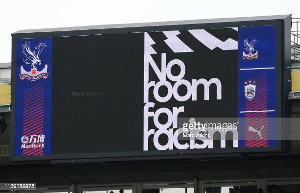 The LED screen displays a message of No room for racism prior to the Premier League match between Crystal Palace and Huddersfield Town at Selhurst...