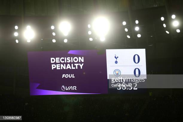 The LED screen displays information during a VAR penalty decision during the Premier League match between Tottenham Hotspur and Manchester City at...