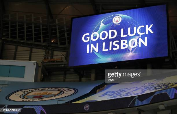 The LED screen inside the stadium displays a good luck message for Manchester City going into the next round of the competition following the UEFA...