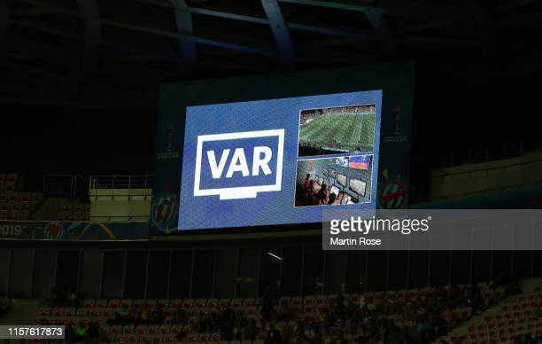 The LED screen inside the stadium shows a VAR review is in place over a penalty decision during the 2019 FIFA Women's World Cup France Round Of 16...