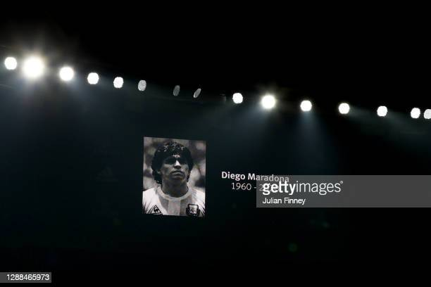 The LED screen shows a picture of Diego Maradona as a minute of silence is held is his memor prior to the Premier League match between Arsenal and...