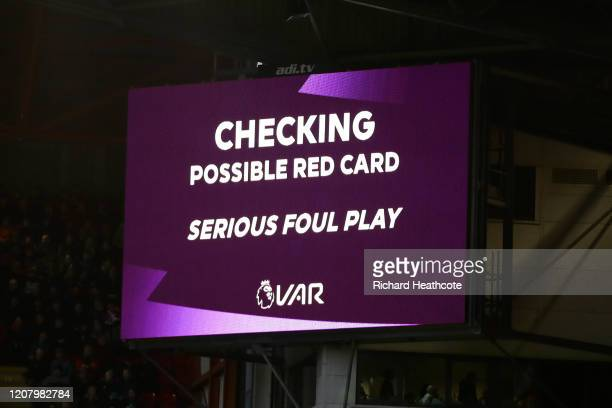The LED screen shows a VAR check for serious foul play during the Premier League match between Sheffield United and Brighton & Hove Albion at Bramall...