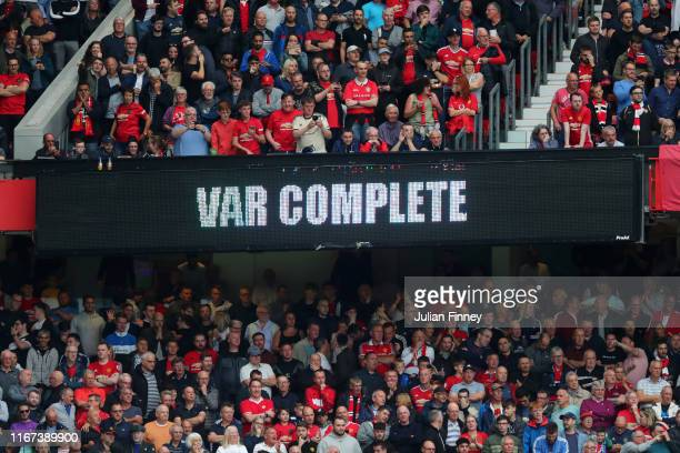The LED screen shows information during a VAR penalty check during the Premier League match between Manchester United and Chelsea FC at Old Trafford...