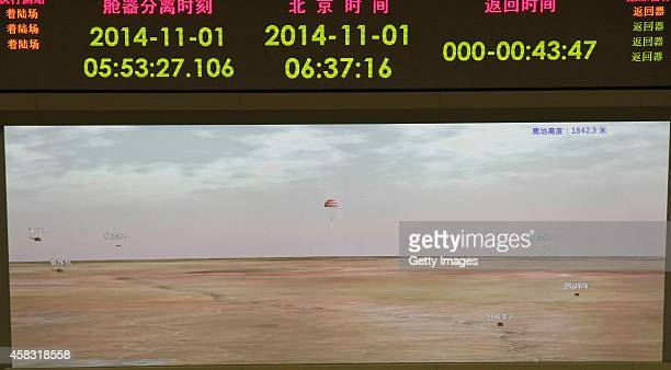 The LED screen shows the mimetic rute of China's Chang'e3 lunar probe returning back at Siziwang Banner on November 1 2014 in Beijing China The lunar...